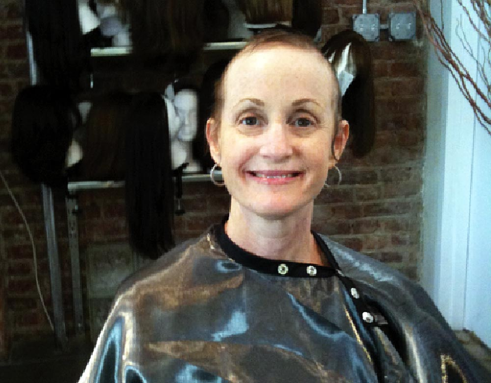 Freed's past wife, Hope, smiles for the camera after shaving her head during cancer treatment. Freed says the picture is a perfect example of the type of person Hope was, still smiling after years of treatment.